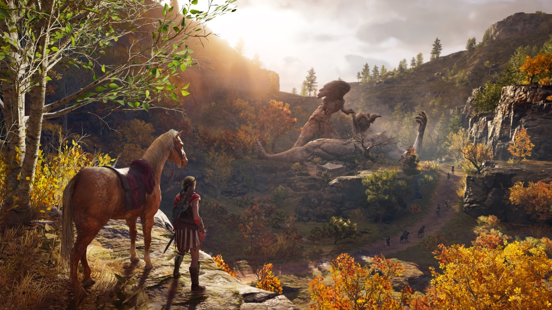 Screenshot of Kassandra with her horse, looking at a statue of Prometheus being eaten by vultures