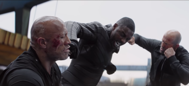 Idris Elba punches The Rock in the face, while Jason Statham punches Idris Elba in the face