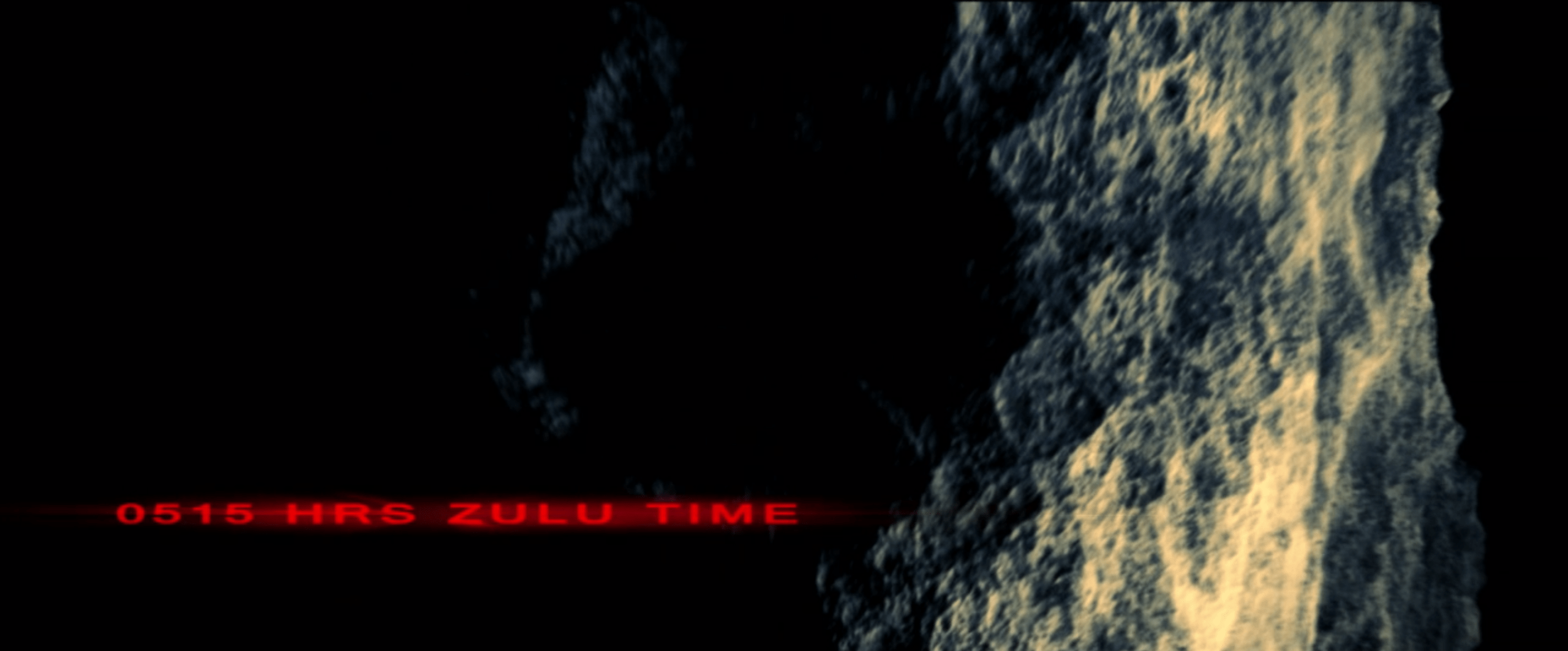 Close-up of asteroid with text saying 0515 HRS ZULU TIME